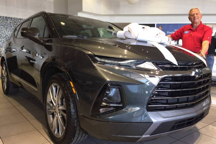 Findlay Chevrolet sales consultant Amos Maly is seen with the 2019 Chevrolet Blazer at the deal ...
