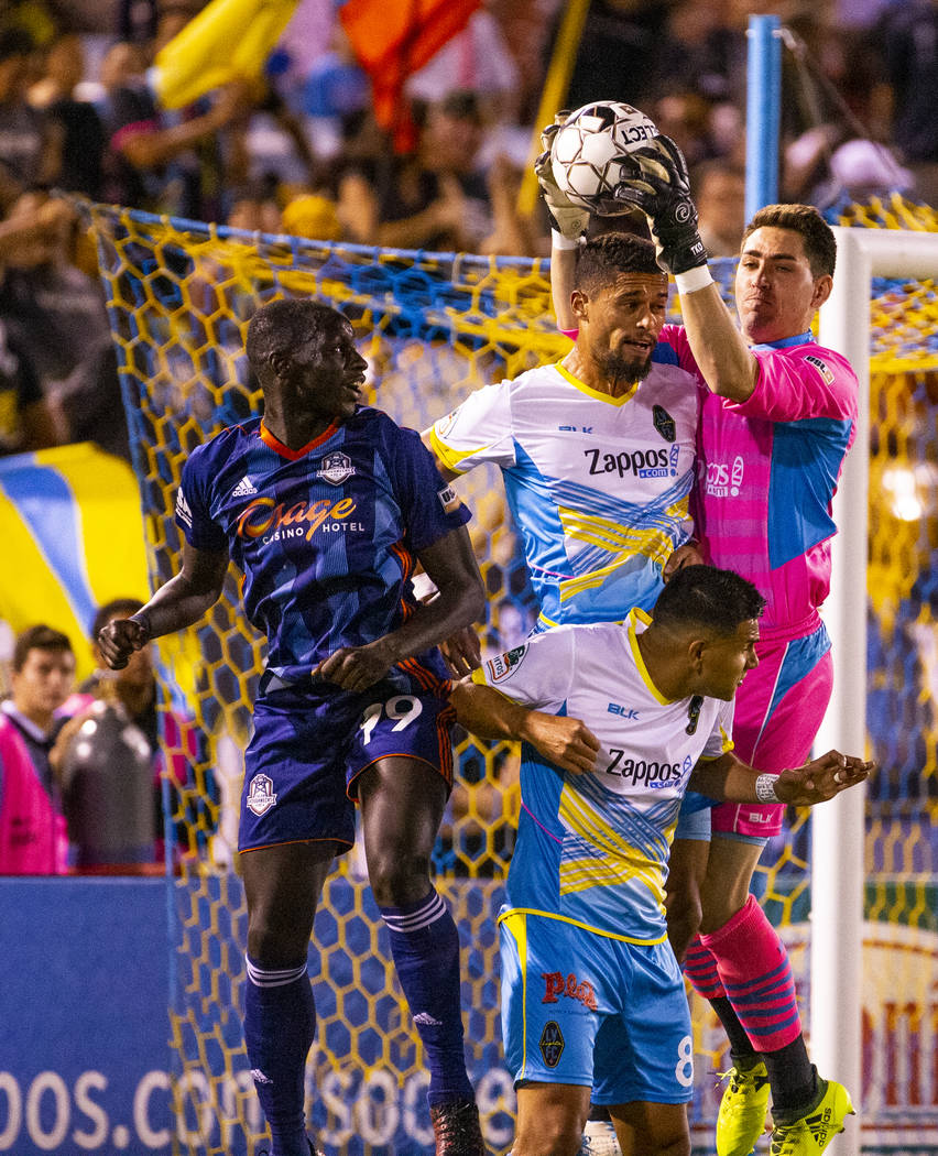 (From right) Las Vegas Lights FC goalkeeper Thomas Olsen (1) grabs a kicked ball above the head ...