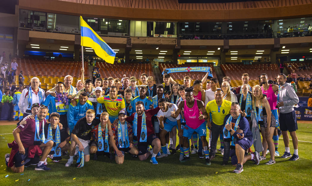Las Vegas Lights FC goalkeeper Thomas Olsen (1) stands for a group photo with visiting IFC Sub ...