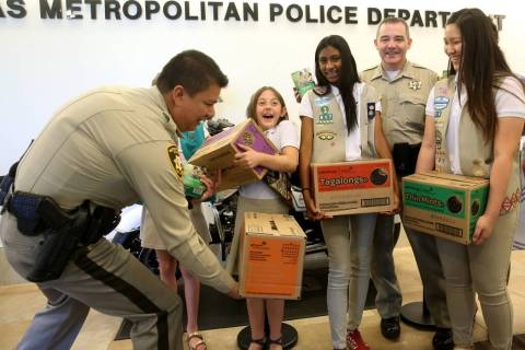 Girl Scouts of Southern Nevada, from left, Kendall Tiffany, 11, Juliette Hoffman, 9, Lily-Renee ...