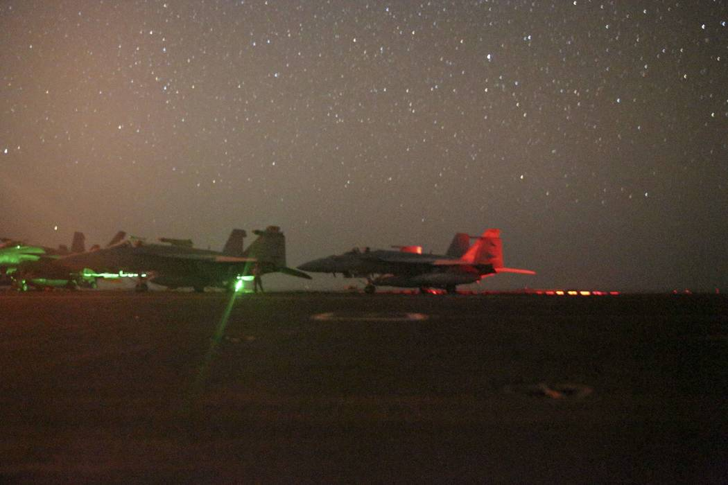 In this photo taken on Sunday, May 26, 2019 and released by the U.S. Navy, F/A-18 Super Hornets ...