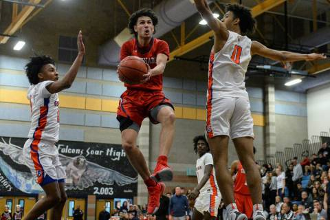 Coronado's Richard Isaacs (2) jumps up to take a shot while being guarded by Bishop Gorman's Za ...