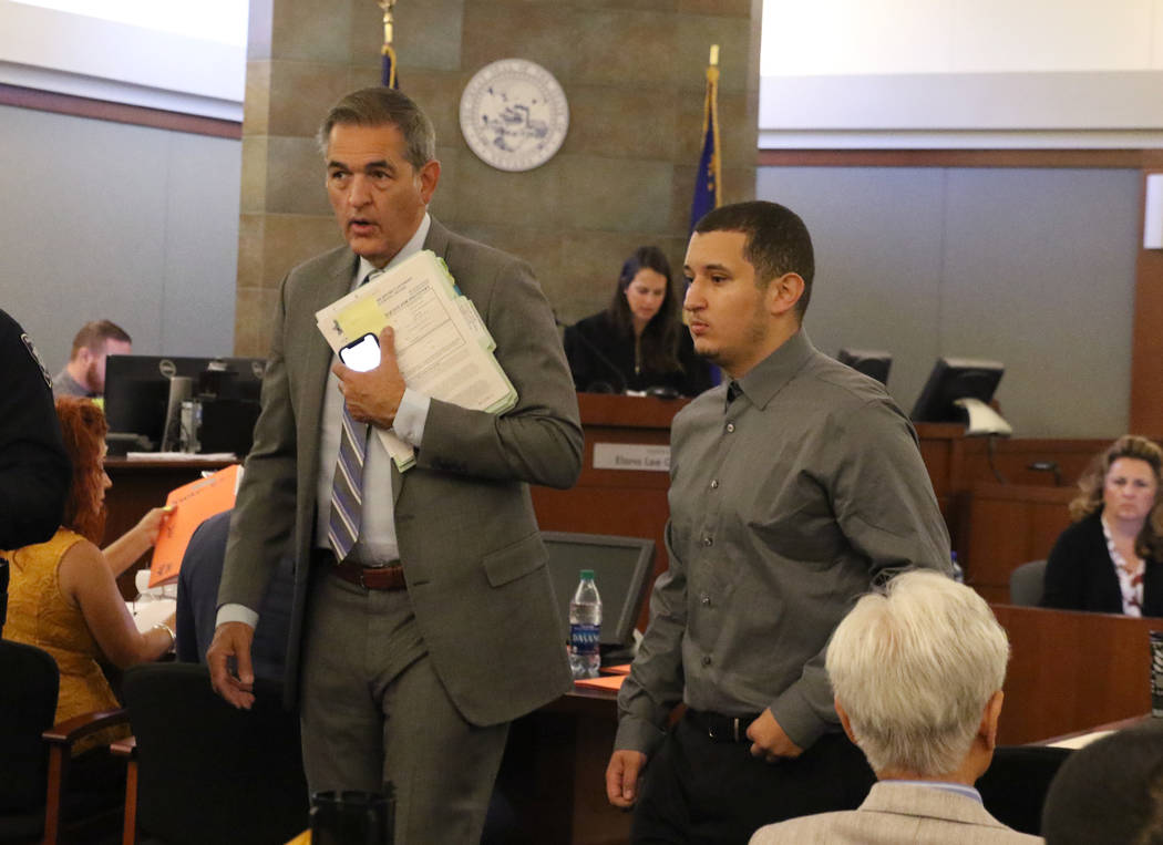 Ryan Mansour, right, charged with attempted murder for driving over his girlfriend after she at ...