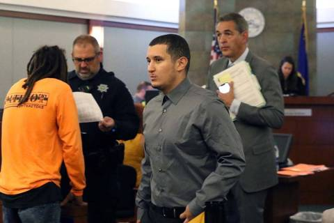 Ryan Mansour, center, charged with attempted murder for driving over his girlfriend after she a ...