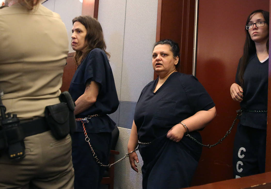 Sherry Marks, center, led into the courtroom during her preliminary hearing at the Regional Jus ...