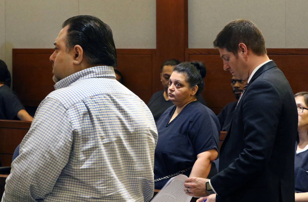 Sherry Marks, center, and her brother David Marks, left, accused of swindling a lawyer out of $ ...