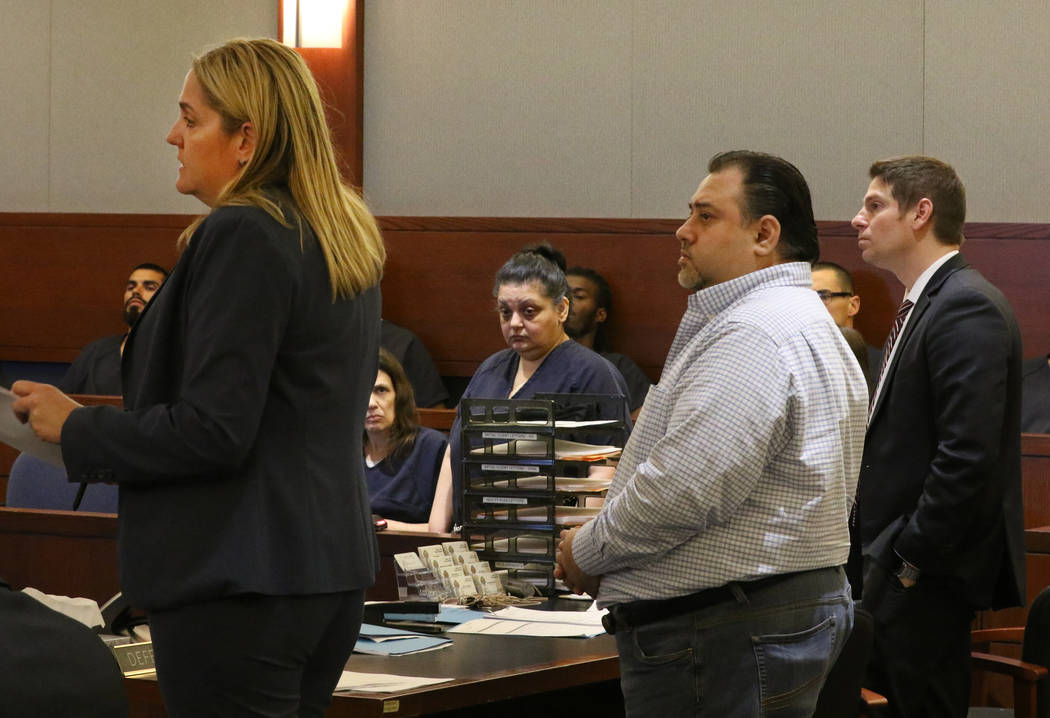 Sherry Marks, second left, and her brother David Marks, second right, accused of swindling a la ...