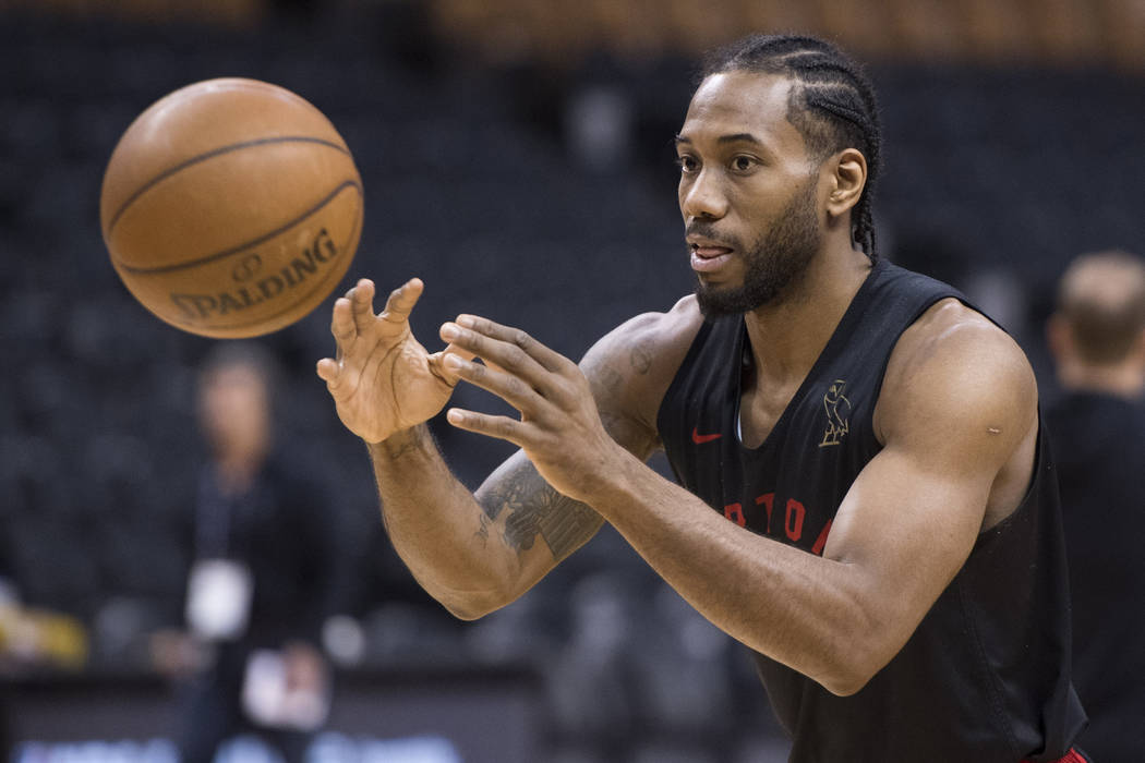 Toronto Raptors' Kawhi Leonard passes during practice for the NBA Finals in Toronto on Wednesda ...