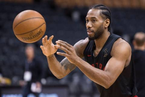 Toronto Raptors' Kawhi Leonard passes during practice for the NBA Finals in Toronto on Wednesda ...