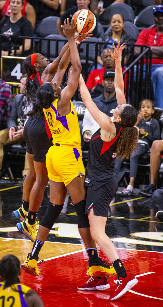 Las Vegas Aces guard Jackie Young (0) rejects a shot by Los Angeles Sparks forward/center Chine ...
