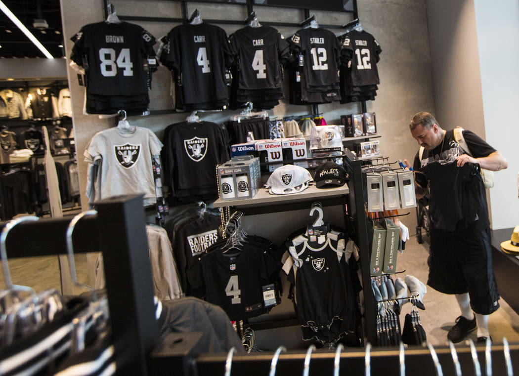 Nickolaus Gerencser, of Baldwin Park, Calif., shops at The Raider Image store at the Galleria a ...