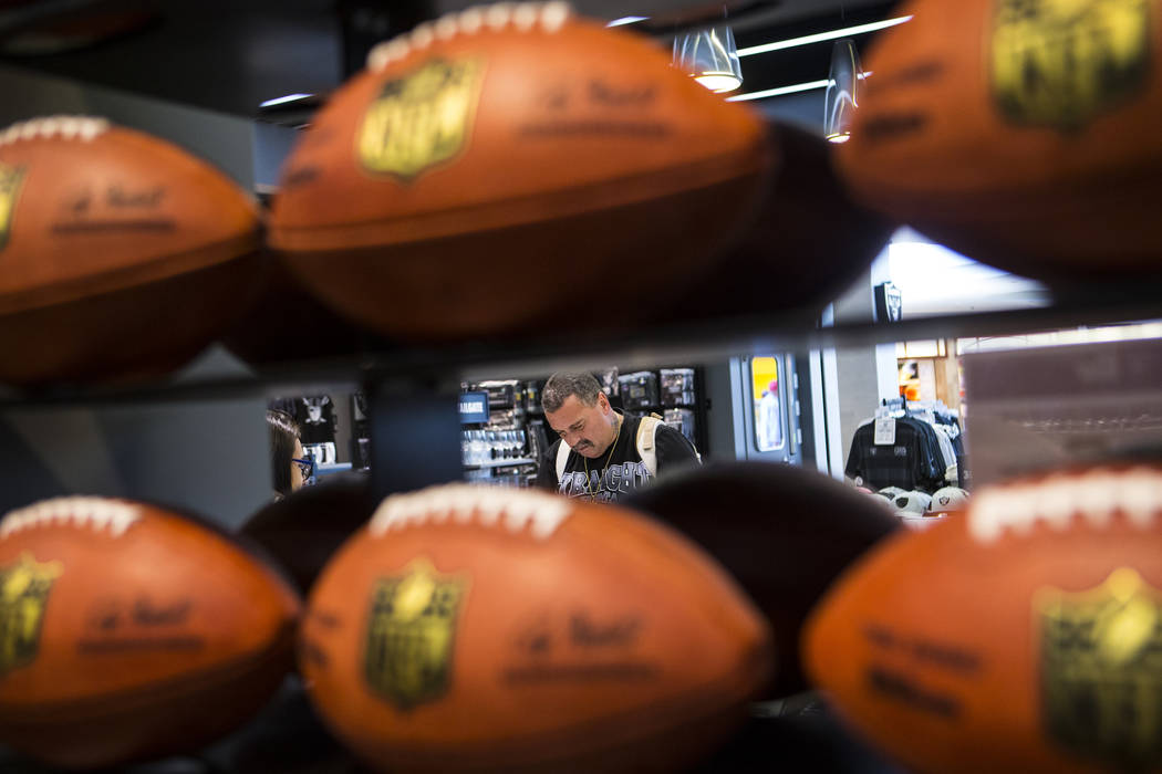 Nickolaus Gerencser of Baldwin Park, Calif., buys items at The Raider Image store at the Galler ...