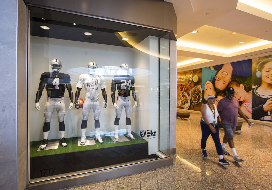 A couple passes by The Raider Image store at the Galleria at Sunset mall in Henderson on Wednes ...