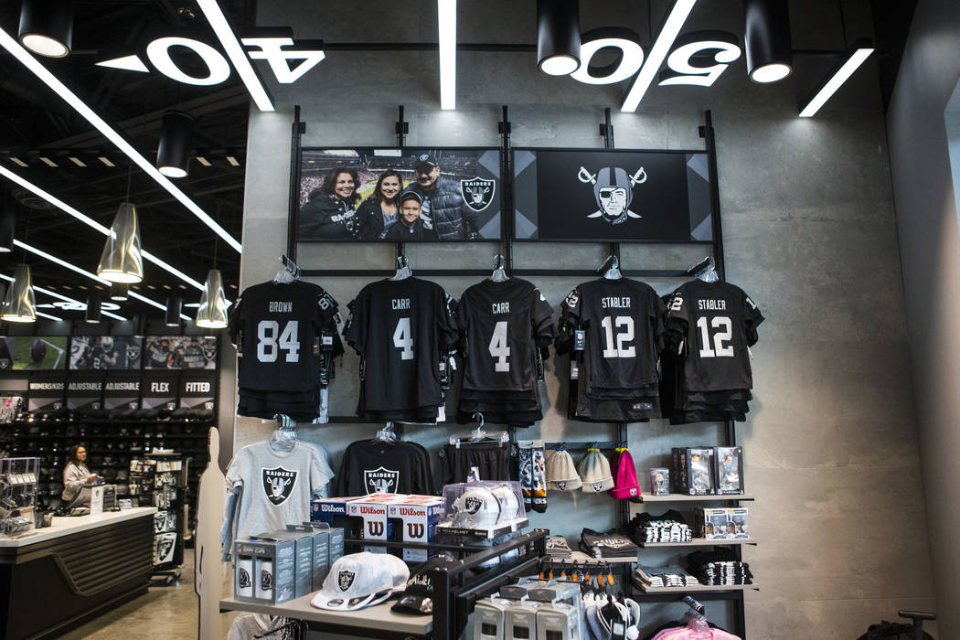 A variety of Raiders apparel at The Raider Image store at the Galleria at Sunset mall in Hender ...