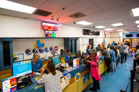 People line up inside of the Primm Valley Lotto Store for Mega Millions lottery tickets in Prim ...