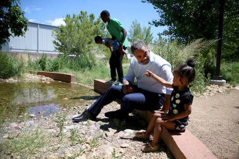 U.S. Rep. Steven Horsford, D-Nev., talks to Ryan Williams, 2, as her father O'Brian Williams ho ...