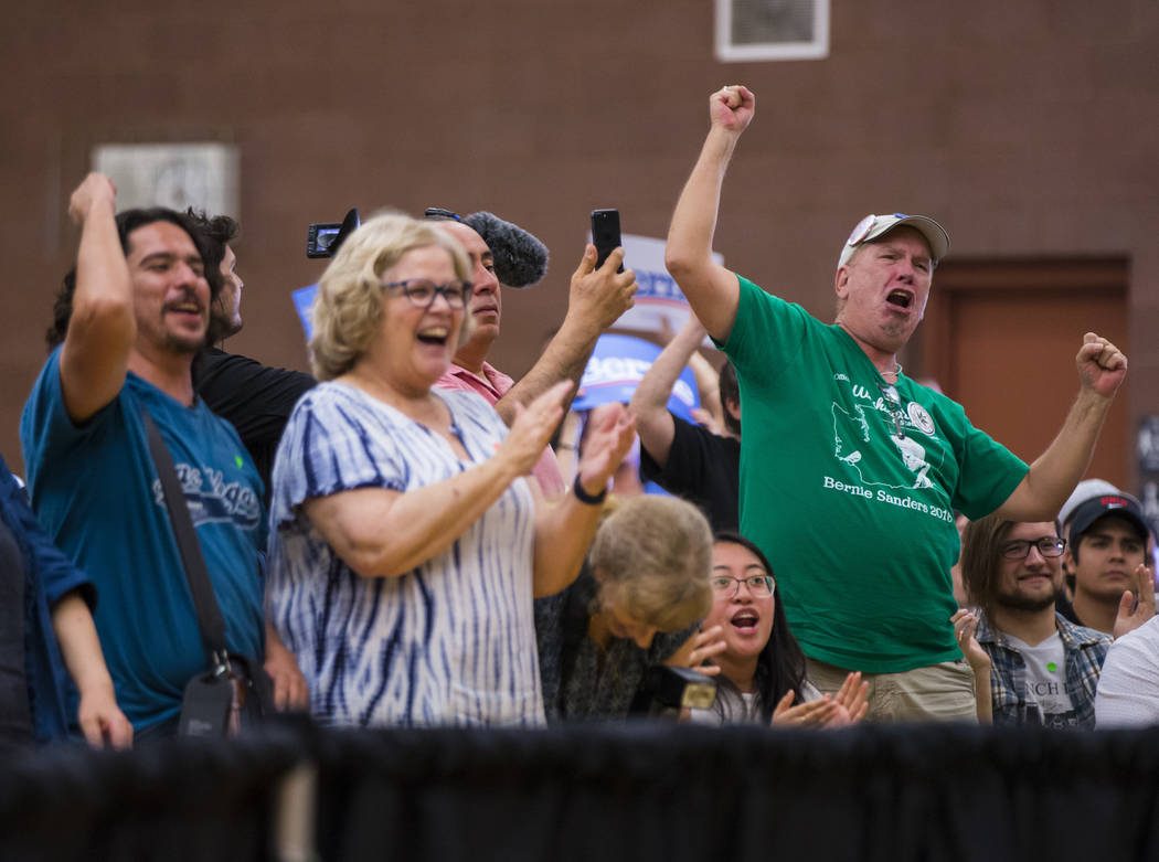 Supporters cheer as Democratic presidential candidate Sen. Bernie Sanders, I-Vt., speaks at a t ...