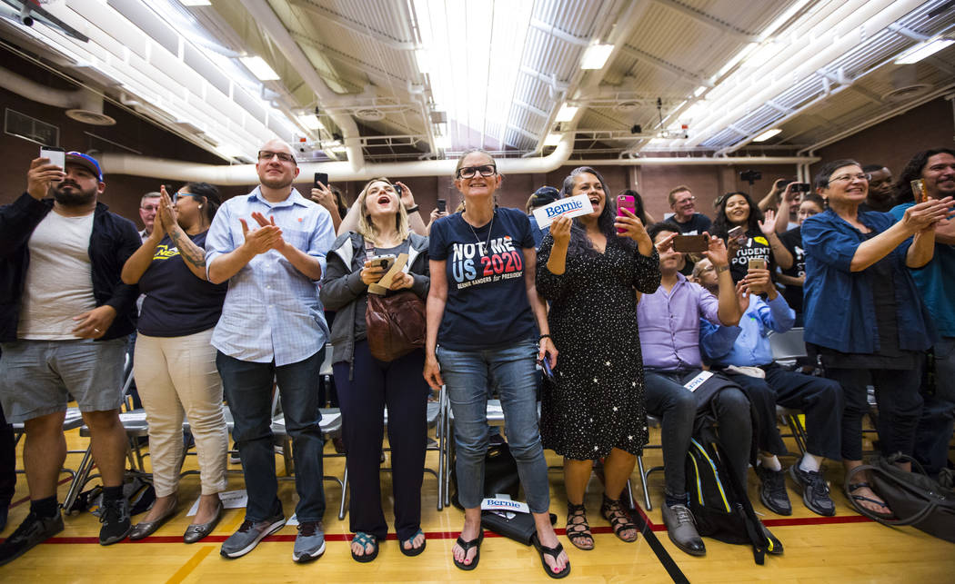 Supporters cheer as Democratic presidential candidate Sen. Bernie Sanders, I-Vt., arrives to sp ...
