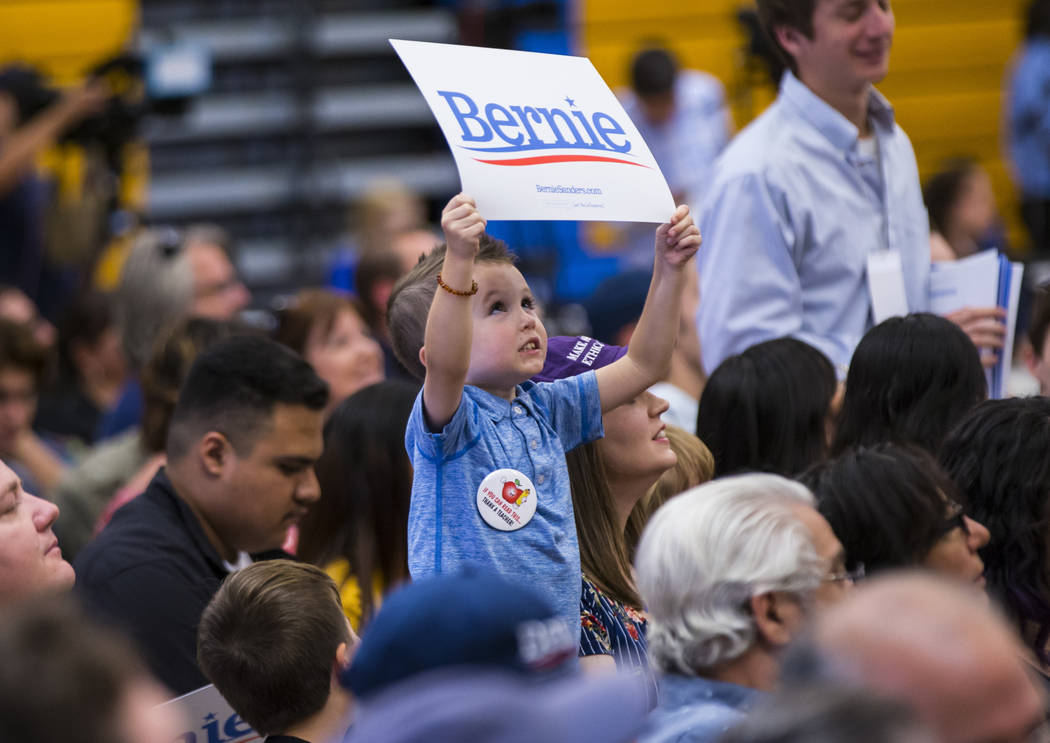 A young supporter holds up a sign in support of Democratic presidential candidate Sen. Bernie S ...