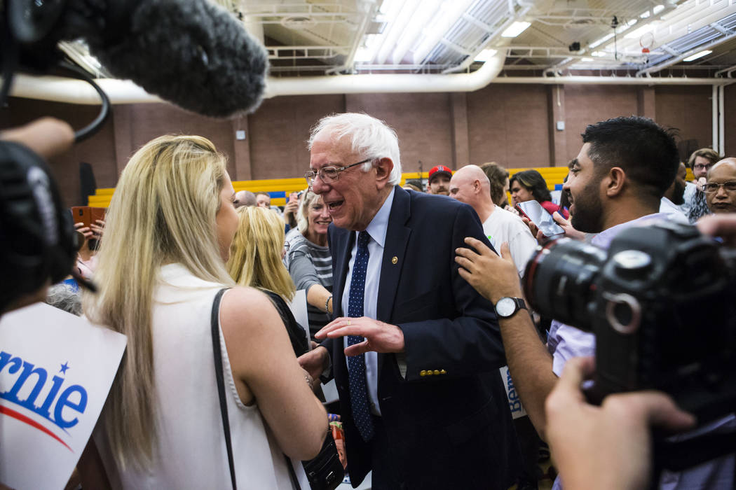 Democratic presidential candidate Sen. Bernie Sanders, I-Vt., greets supporters after a town ha ...