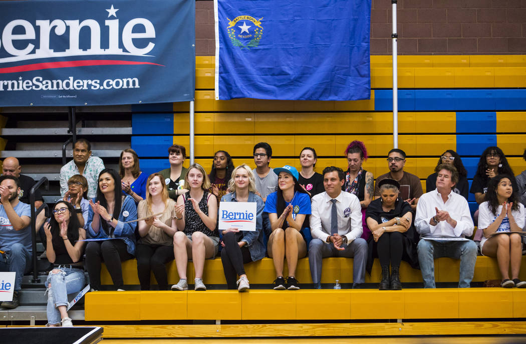 Supporters listen to Democratic presidential candidate Sen. Bernie Sanders, I-Vt., during a tow ...