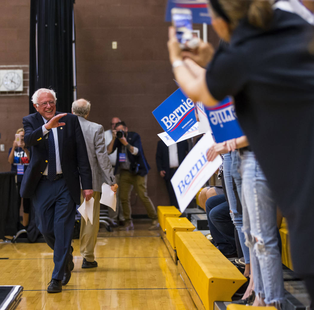 Democratic presidential candidate Sen. Bernie Sanders, I-Vt., motions to the crowd at a town ha ...