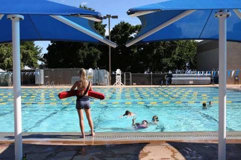 Pool lifeguard Sophia Morris watches as children swim at Boulder City pool on Wednesday, May 29 ...