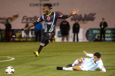 Las Vegas Lights FC midfielder Alex Nyarko Harlley (14) jumps over Austin Bold FC forward Julia ...