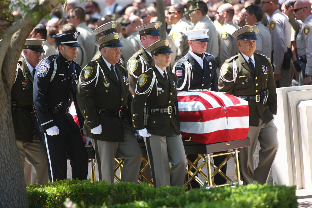 Honor guard officers escort the casket of fallen Las Vegas police officer Alyn Beck during fune ...