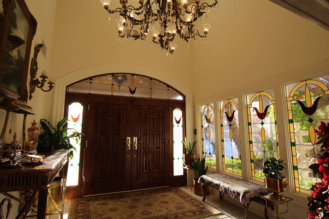 Mt. Charleston Realty The entry way features stained-glass windows and a large chandelier.