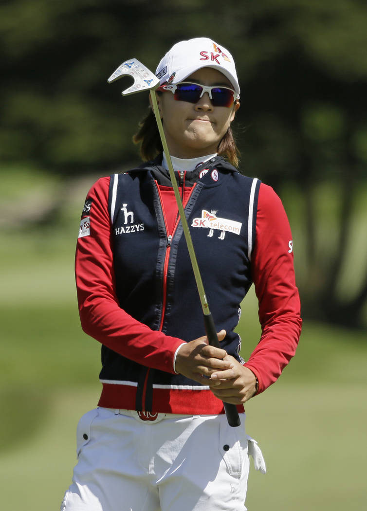Na Yeon Choi, of South Korea, follows her putt on the fifth green of the Lake Merced Golf Club ...