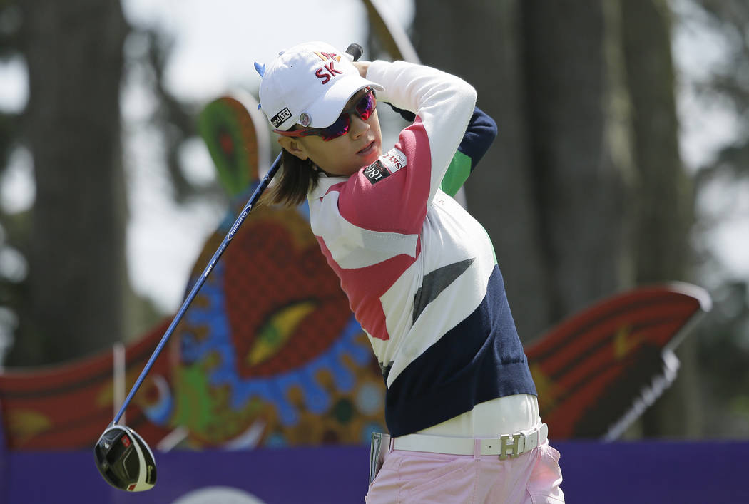 Na Yeon Choi, of South Korea, follows her drive from the second tee of the Lake Merced Golf Clu ...