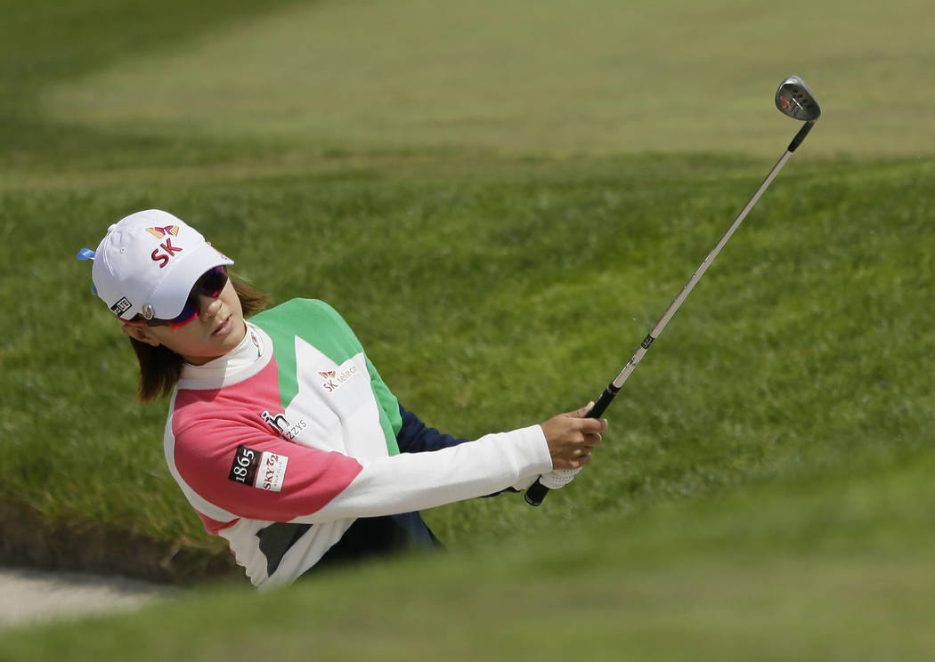 Na Yeon Choi, of South Korea, hits out of a bunker up to the fifth green of the Lake Merced Gol ...