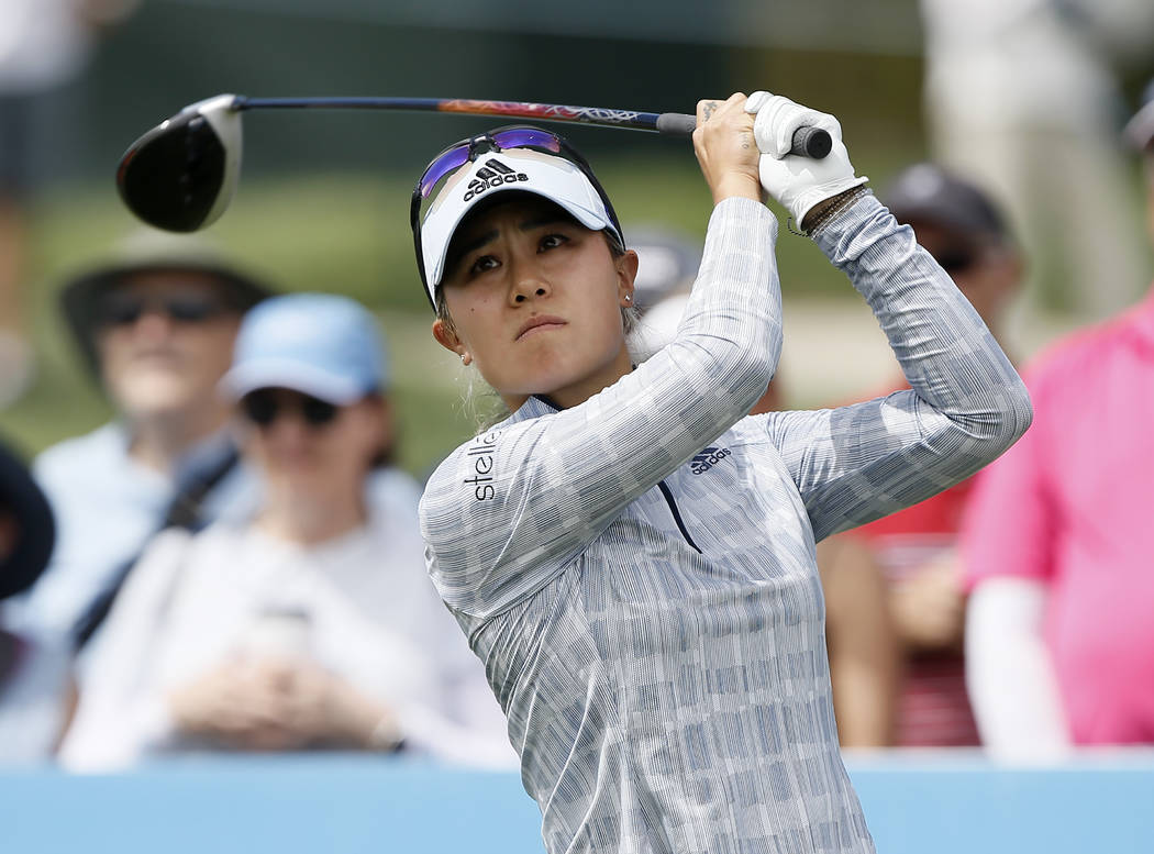 Danielle Kang watches her shot on the second tee during the final round of the LPGA Tour ANA In ...