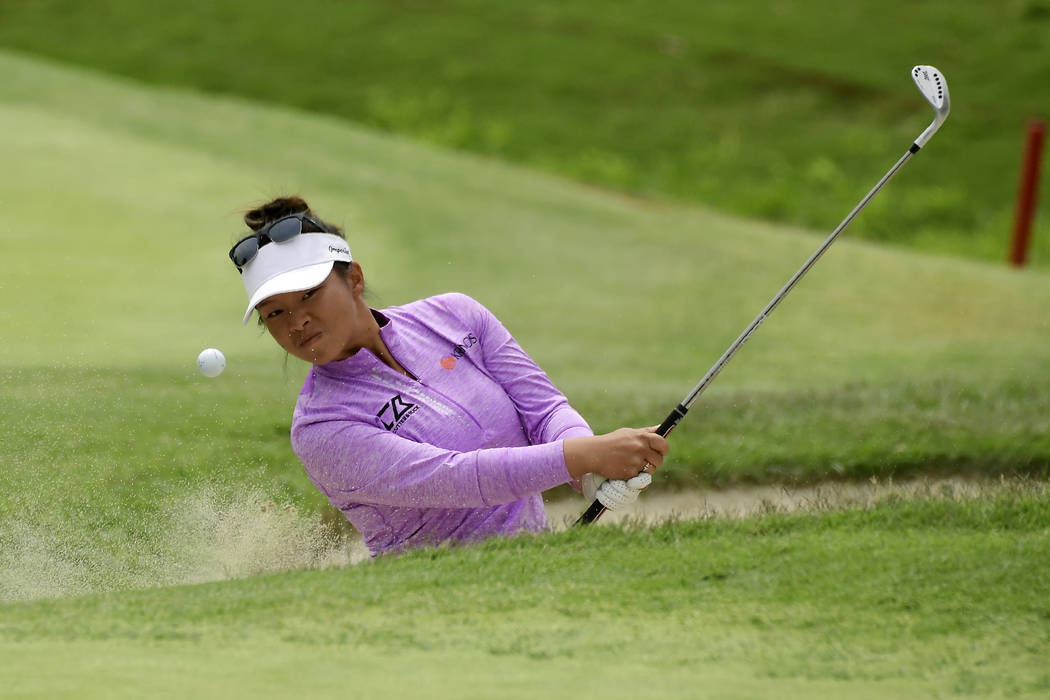 Danielle Kang hits out of a bunker on the fourth hole during the final round of the Hugel-Air P ...