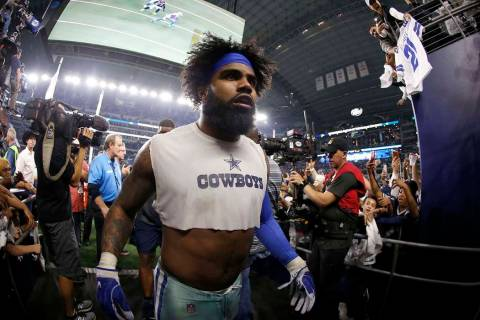 Dallas Cowboys running back Ezekiel Elliott (21) heads to the clubhouse after an NFC wild-card ...