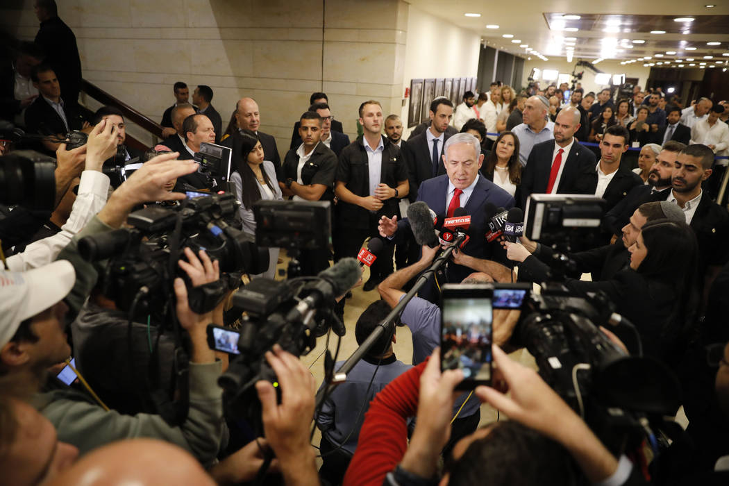 Israeli Prime Minister Benjamin Netanyahu speaks to the media after voting in the Knesset, Isra ...