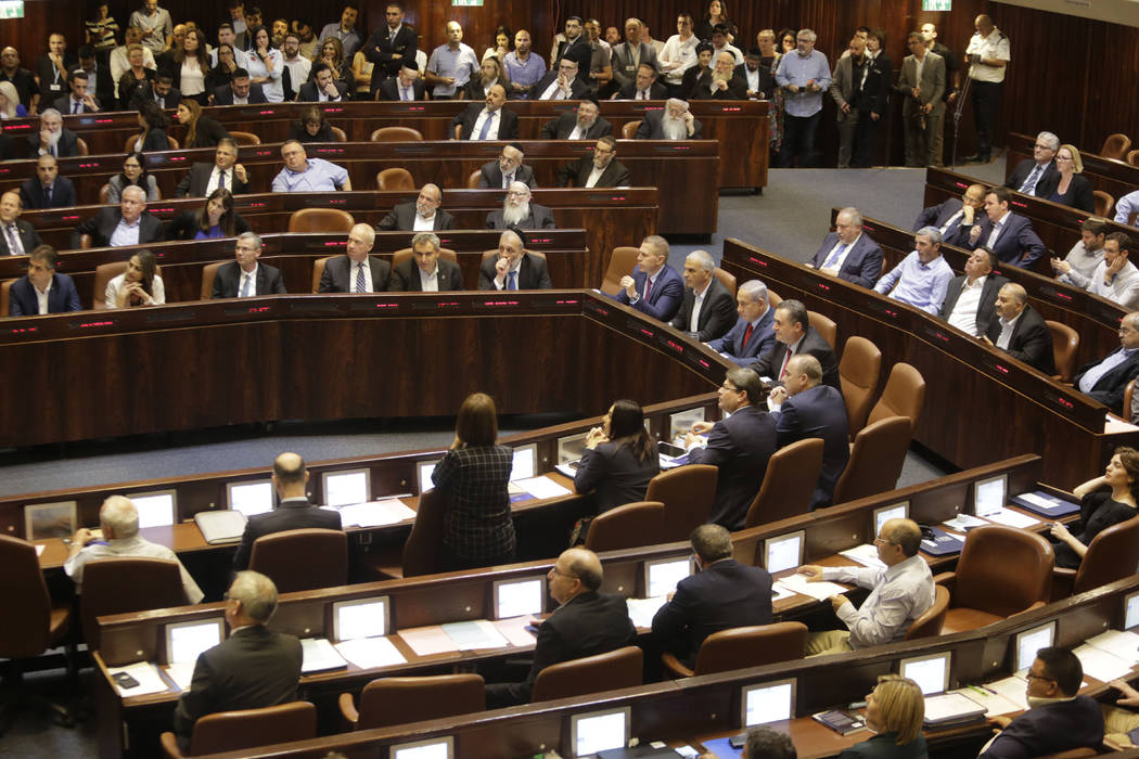 Israeli Ministers and Parliament Members in their chairs before voting in the Knesset, Israel's ...