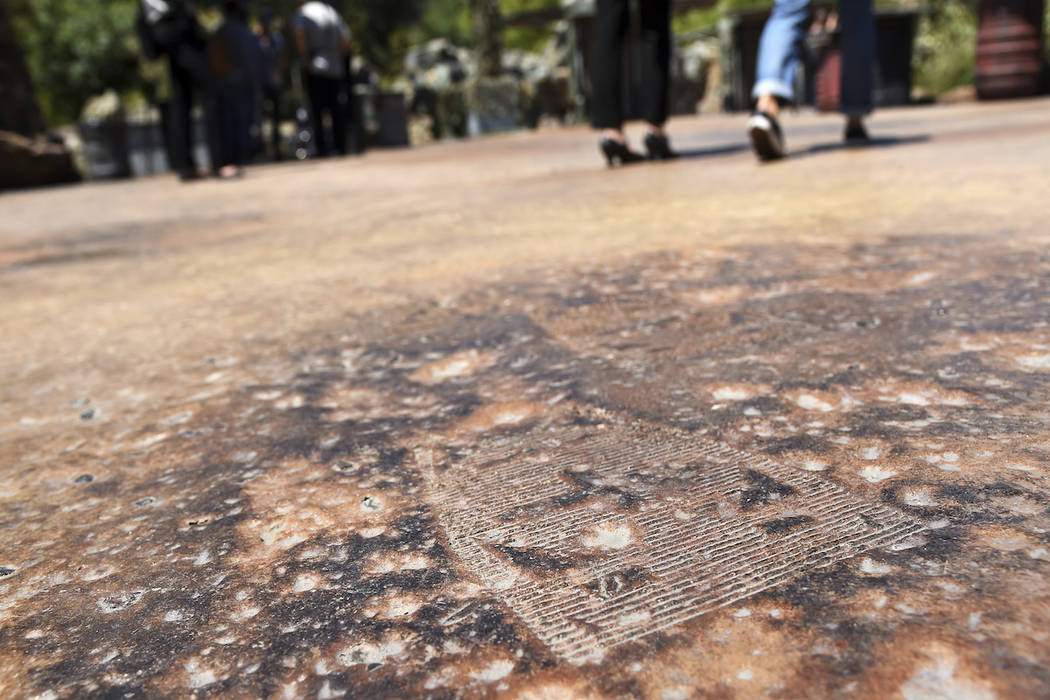 A GNK power droid footprint is pictured on a walking path during the Star Wars: Galaxy's Edge M ...