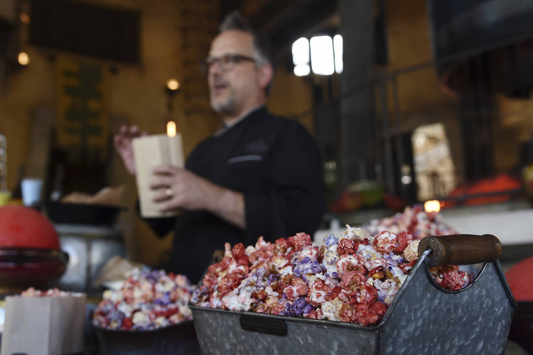Flavored popcorn from Kat Saka's Kettle is pictured as John D. State, culinary director of Disn ...