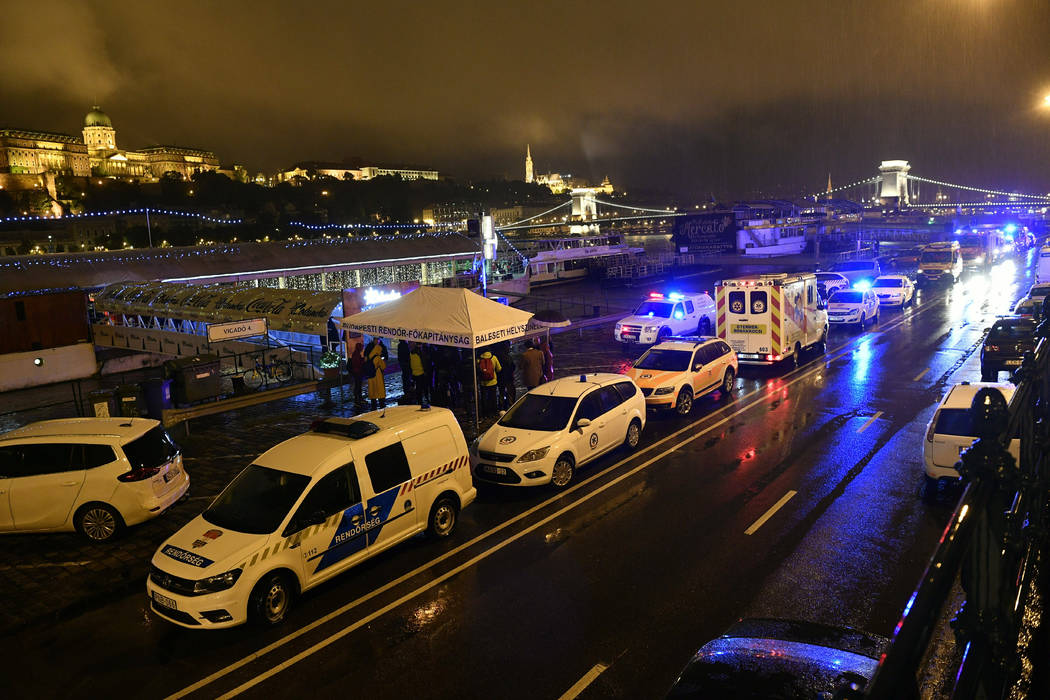 Police and ambulances are parked on the river bank early Thursday, May 30, 2019 after a tourist ...