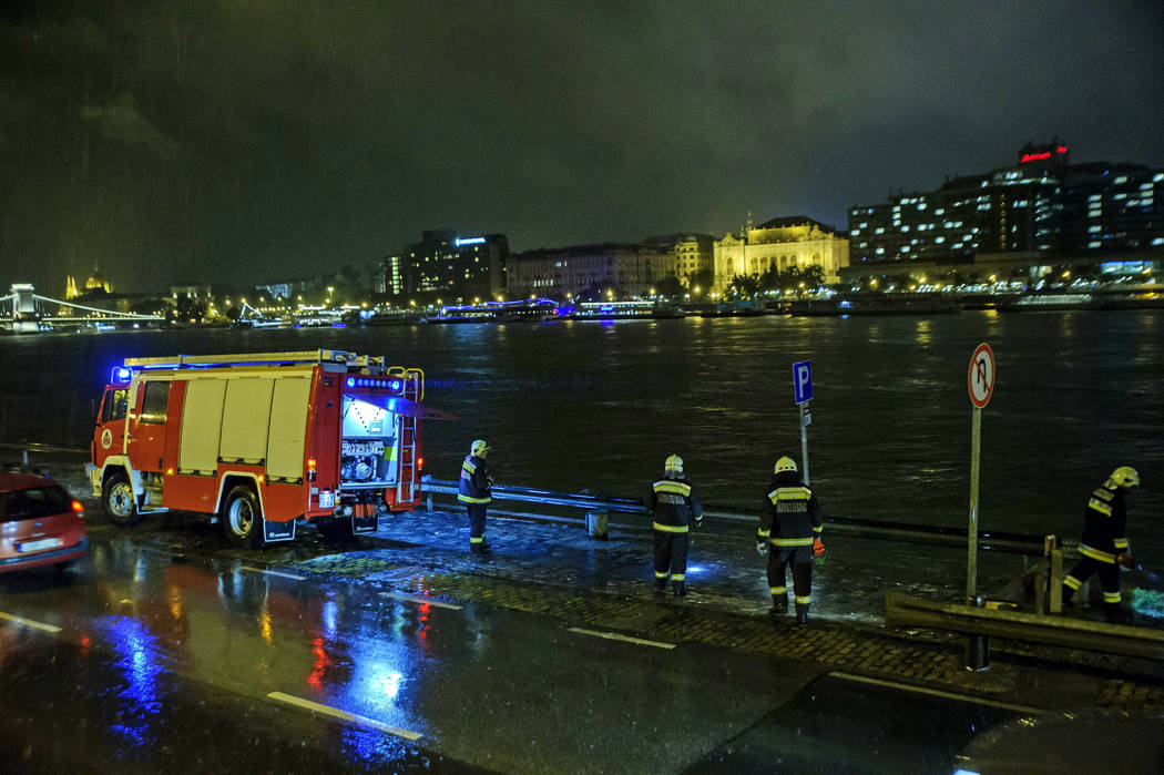 Rescuers search for victims on the river bank early Thursday, May 30, 2019 after a tourist boat ...