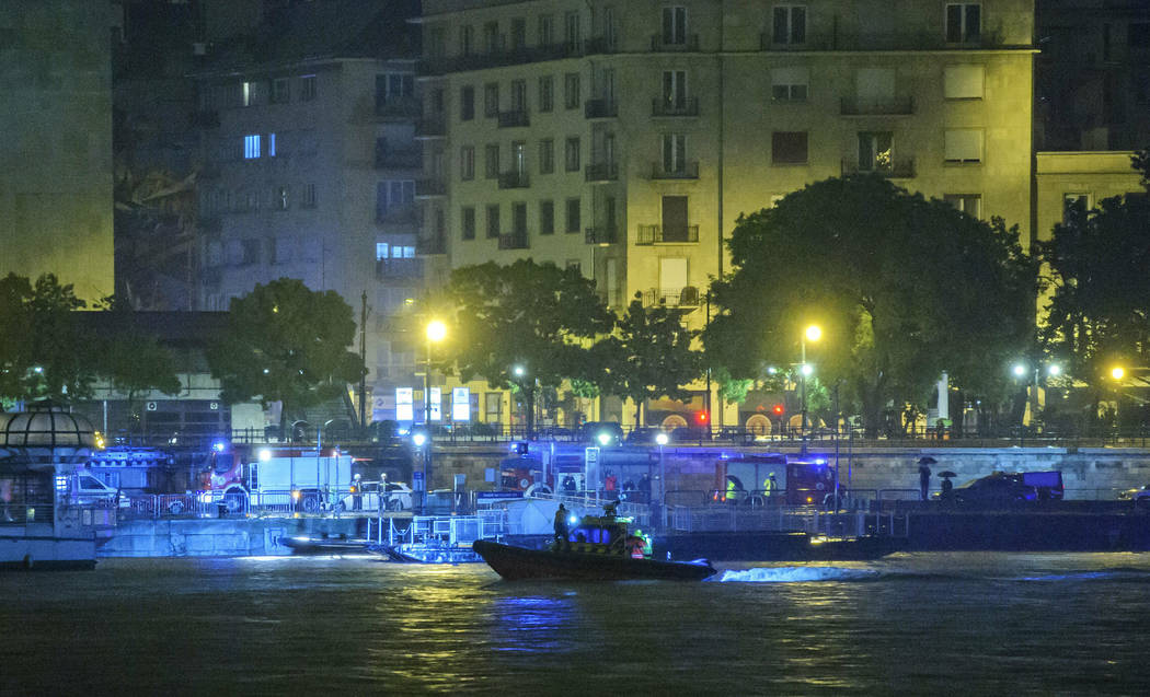 A rescue boat searches for victims late Wednesday, May 29, 2019, after a tourist boat crashed w ...