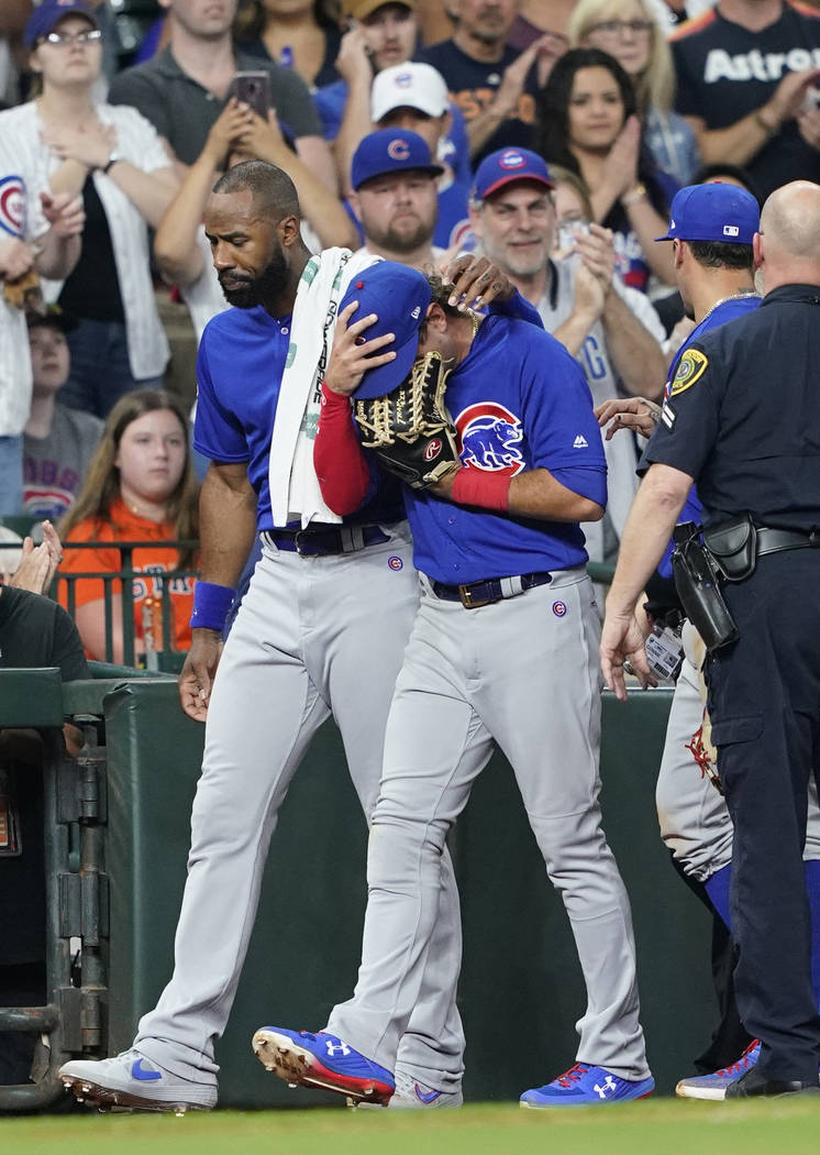 Chicago Cubs' Albert Almora Jr., right, is comforted by Jason Heyward after checking on an inju ...