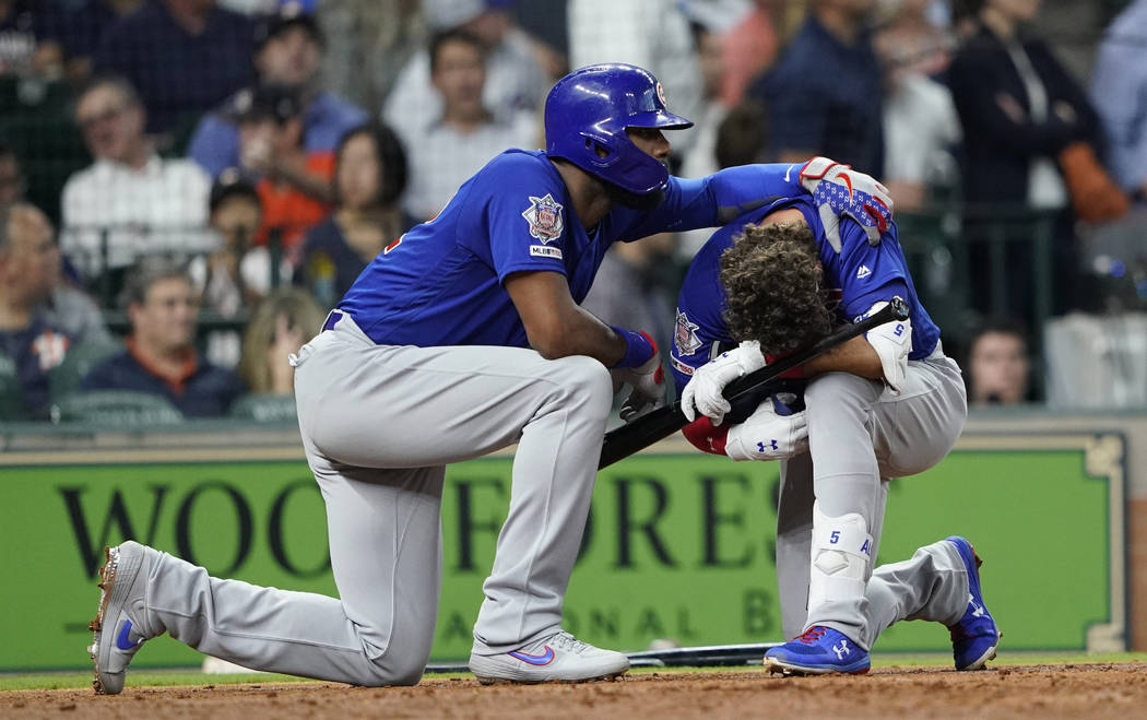 Chicago Cubs' Albert Almora Jr., right, is comforted by Jason Heyward after hitting a foul ball ...