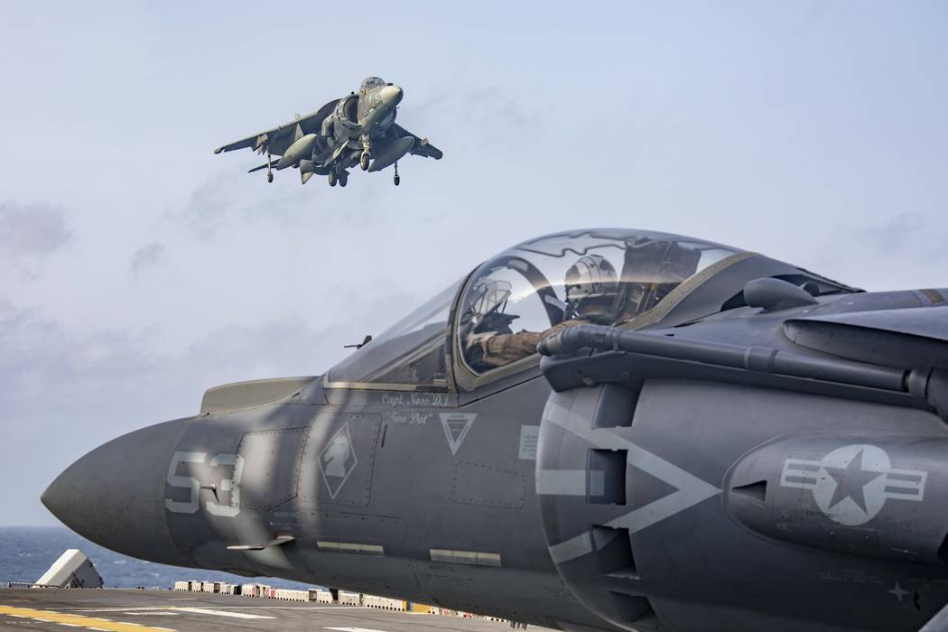 In this May 18, 2019 photo, AV-8B Harriers return to the flight deck of the Wasp-class amphibio ...