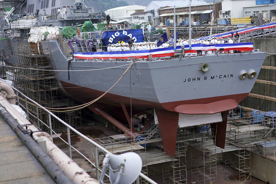 The USS John S. McCain under repair at a dry dock is seen prior to the rededication ceremony fo ...