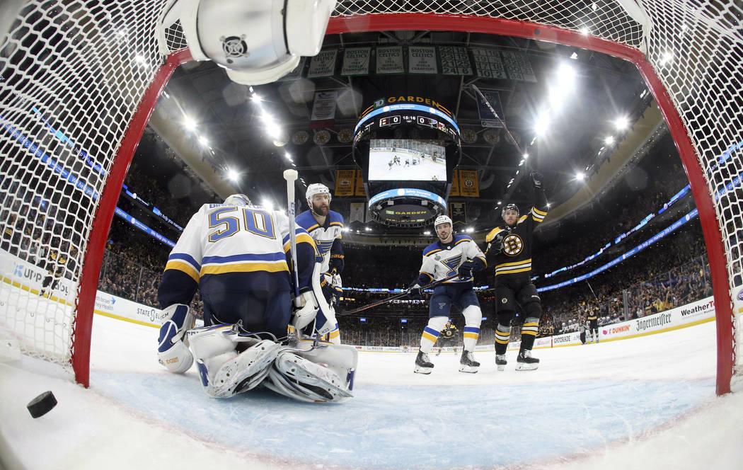 Boston Bruins' Charlie Coyle, right, celebrates his power play goal against St. Louis Blues goa ...
