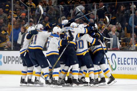 The St. Louis Blues mob Carl Gunnarsson, of Sweden, who scored the winning goal against the Bos ...
