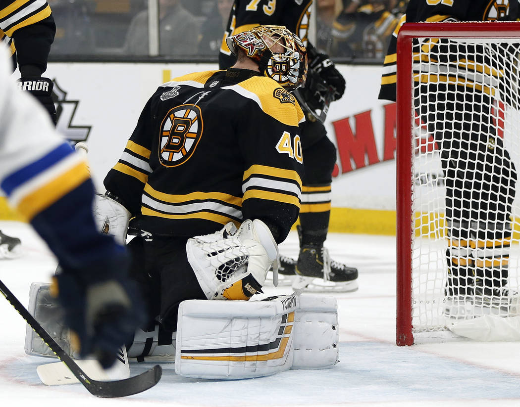 Boston Bruins goaltender Tuukka Rask, of Finland, reacts after allowing a goal by St. Louis Blu ...